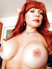 Redhead mature bombshell in nylons undressing and teasing her gash