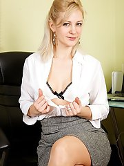 Lovely blonde babe takes off her skirt to play with herself in office