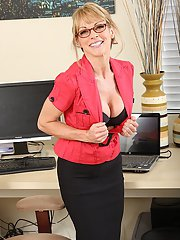 Mature babe in glasses undressing and revealing her big titted hot body