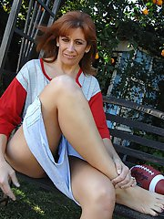 Lusty mature lady undressing and exposing her hairy gash outdoor