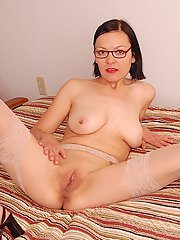 Naughty european MILF in glasses reveals her bosoms and inviting pussy