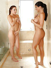 Playful lesbians have some soapy humping fun in the shower