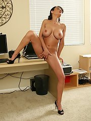 Top-heavy MILF teasing her gash with her fingers at her workplace