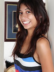 Playful latina cutie in jeans undressing and spreading her legs