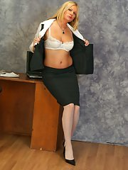 Busty MILF in glasses and white stockings undressing and teasing herself