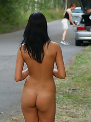 Frisky brunette amateur exposing her sexy curves in the public place