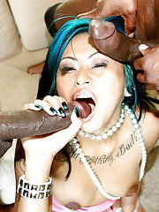 Salacious asian chick blows and fucks two black dongs for cum in her mouth