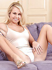 Well-stacked blondie taking off her undies and exposing her trimmed slit