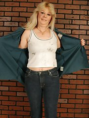 Smiley mature blonde with chubby curves undressing and exposing her goods