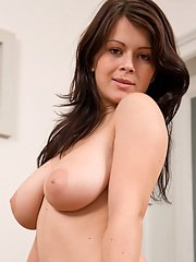 Tempting amateur with ample bosoms posing nude and teasing her slit