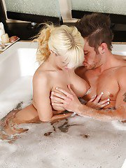 Juggy blonde masseuse teases her client and gives a blowjob on his big boner
