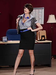 Glamorous MILF undressing and exposing her goods at her workplace