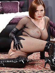 Ravishing redhead MILF posing in provocative nylon and latex outfit