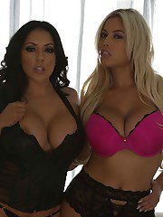 Two steamy latina bombshells in lingerie revealing their messive jugs