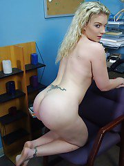 Nasty office MILF slowly uncovering her goods at her workplace