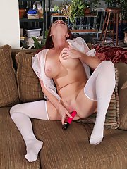 Chubby MILF in white nylons toying her gash and licking her nipples