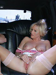Chippy blonde MILF in nylons reveals her goods and gives head in the car