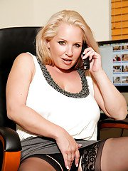 Top-heavy mature office lady undressing and fingering her hungry twat