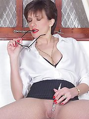 Sassy fetish lady in glasses and dress clothes revealing her boobs and gash