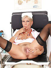 Filthy mature nurse in nylons stuffing her cunt with toys and med tools
