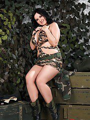 Buxom chick in military outfit reveals her big jugs and teases her gash