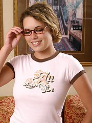 Foxy teen with adorable smile and pierced belly button takes off her clothes