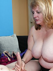 Slutty mature plumper milking a stiff cock with her mouth and huge melons