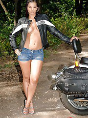 Steaming hot biker girl revealing her amazingly sexy curves outdoor