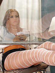 Steaming hot floosie with nylon clad legs gives a sensual footjob