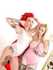 Glamorous tattooed vixens make some steamy lesbian humping action