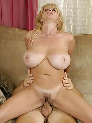 Top-heavy blonde cougar gets shafted and milks a boner with her mouth
