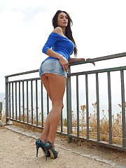 Foxy brunette flashing her panties and revealing her boobs outdoor