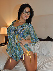 Naughty latina lady in glasses slowly uncovering her round boobies