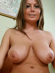 Deep-bosomed MILF licking her hard nipples and fingering her gash