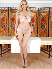 Big busted blonde massage lady gets rid of her gown and lingerie