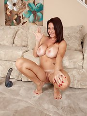 Lecherous top-heavy MILF with trimmed cooter riding a big dildo