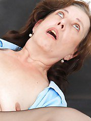 Lecherous mature nurse in stockings pleasing herself with a vibrator