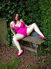 Fatty mature lassie uncovering her flabby curves and exposing her hairy gash