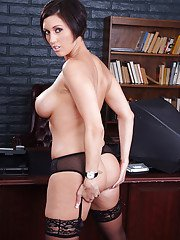 Stunning office lady in nylons undressing and posing on her desk