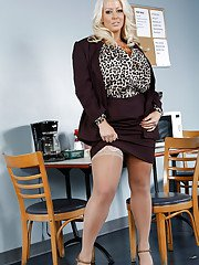 Curvaceous platinum blonde MILF undressing and fingering her slit