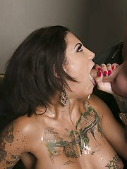 Perky tattooed vixen in black nylons gets her pussy licked and slammed tough