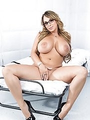 Top-heavy MILF in glasses gets rid of her dress clothes and lingerie
