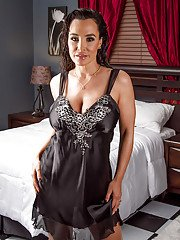 Steamy mature temptress in lingerie uncovering her jaw-dropping hot curves