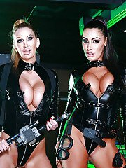 Steaming hot vixens in hot latex suits demonstrating their huge boobs