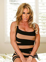 Well-toned blonde MILF in tiny striped dress revealing her round jugs