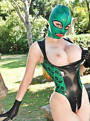 Hot fetish vixen in latex mask and suit exposing her boobs and honey pot
