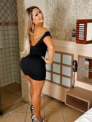 Curvy latina MILF in tiny dress flashing her jugs and teasing her slit