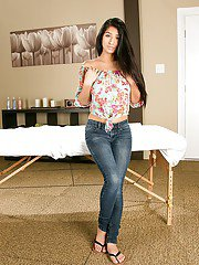 Playful latina lovely in blue jeans slowly uncovering her gorgeous curves