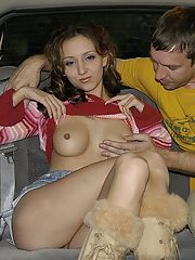 Perky teenie goes down on a stiff cock and gets on top of it in the car