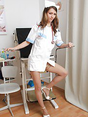 Skinny gyno nurse playing with a vibrator and medical tools